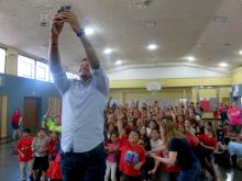 Carlos Martines takes a selfie with St. Cecilia